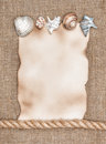 Aged paper with sea shells and rope on sacking background texture of Royalty Free Stock Photos