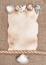 Aged paper with sea shells and rope on sacking background texture of Stock Photos