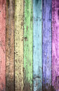 Aged rainbow painted wooden fence Royalty Free Stock Images
