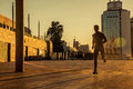 Aged sportsman running on country road, healthy inspirational fitness lifestyle, sport motivation speed interval training. Royalty Free Stock Photo