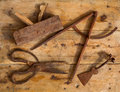 Aged tools wood planer wool scissors drawing compass Royalty Free Stock Image