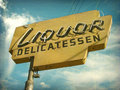 Aged vintage liquor store sign Royalty Free Stock Photo