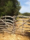 Aged vitage wooden gates close countryside road, rustic scene somewhere in european farm Royalty Free Stock Photo