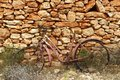 Aged weathered bicycle vintage stone wall Stock Photo