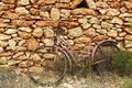 Aged weathered bicycle vintage stone wall Stock Photos