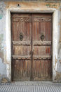 Aged wood door in calella catalonia spain Stock Images