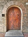 Aged wooden entrance door with arch Royalty Free Stock Photo