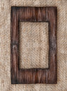 Aged wooden frame on the burlap Royalty Free Stock Photo