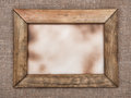 Aged wooden frame on hessian Royalty Free Stock Photo