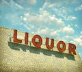 Aged and worn vintage liquor store sign Royalty Free Stock Photo