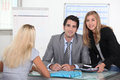 Agency estate employees with a client Stock Images