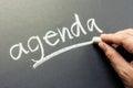 Agenda hand writing topic on chalkboard Stock Photos