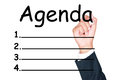 Agenda list write by businessman on white background Royalty Free Stock Photo