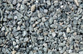 Aggregate - light gray coarse stones, crushed at a stone pit, gravel pattern Royalty Free Stock Photo