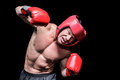 Aggressive boxer against black background puching Stock Photos