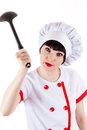 Aggressive chef brandishing a ladle Stock Image
