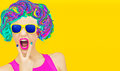 Aggressive party girl multicolors blast on yellow background Royalty Free Stock Image