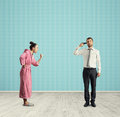 Aggressive wife and stressed husband Royalty Free Stock Photo