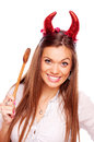 Aggressive woman beautiful brunette with red devil horns and wooden mixing spoon isolated on white Stock Image