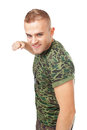 Aggressive young army soldier strikes blow with the clenched fist isolated on white background Royalty Free Stock Photography