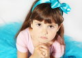 Aggrieved girl portrait little face studio shot Royalty Free Stock Image