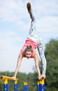 Agile young gymnast balancing on cross bars Royalty Free Stock Photo