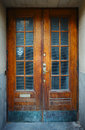 Aging door with ghost face over window stockholm sweden Stock Photos