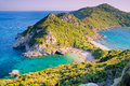 Agios Georgios beach in sunset, Corfu Royalty Free Stock Photo