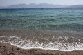 Agios nikolaos sandy beach and sea Stock Photography