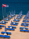 Agios nikolaos seaside resort in crete greece sun beds and parasols on a jetty the of Royalty Free Stock Photo