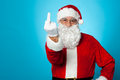 Agitated Santa showing his middle finger Stock Photo