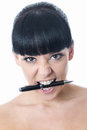 Agitated Stressed Frustrated Young Woman with Pen in Mouth Royalty Free Stock Photo