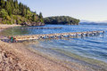 Agni beach corfu mooring jetties in the charming cove of on the north eastern coast of greece Stock Photo