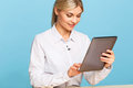 Agreeable tv announcer preparing for broadcasting nice day cheerful beautiful professional holding laptop and keeping glance down Stock Photos