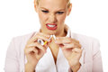 Agressive business woman breaking cigarette Royalty Free Stock Photo