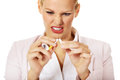 Agressive business woman breaking cigarette Stock Images