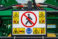 Agricultural equipment detail panel with safety warning signs at work placed on Stock Images