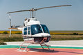 Agricultural helicopter on heliport Stock Photo
