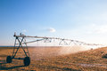 Agricultural irrigation on harvested wheat stubble field Royalty Free Stock Photo