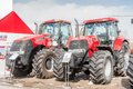 Agricultural machinery exhibition tyumen russia april iv specialized and equipment tractor demonstration on platform open Stock Image