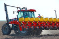 Agricultural machinery sowing tractor and seeder for Royalty Free Stock Images