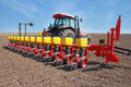 Agricultural machinery sowing tractor and seeder for Royalty Free Stock Photo