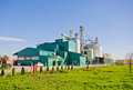 Agricultural plant exterior of building with silos in background Royalty Free Stock Images