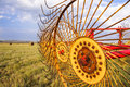 Agriculture hay rake machine for bales in line metal wheels on a mechanical star wheel used to make windrows from cut grass on a Royalty Free Stock Images