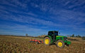 Agriculture landscaped farm tractor preparing the soil and ranking the field before plating montijo badajoz extremadura spain Stock Photo