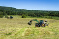 Agriculture machinery on hay field Royalty Free Stock Photo