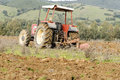 Agriculture tractor plowing Sardinia Royalty Free Stock Photos