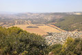 Agriculture valley with fields and arab village, Israel. Royalty Free Stock Photo