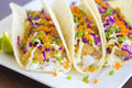 Ahi katsu sushi tacos fried breaded tuna rice purple cabbage green onions masago capelin fish roe and wasabi mayonnaise on corn Stock Image