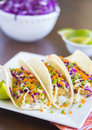 Ahi katsu sushi tacos fried breaded tuna rice purple cabbage green onions masago capelin fish roe and wasabi mayonnaise on corn Royalty Free Stock Photo